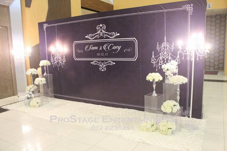 Luxurious themed wallpaper with dark blue, white, silver colour and decorated with bouquet stands and mini chandeliers