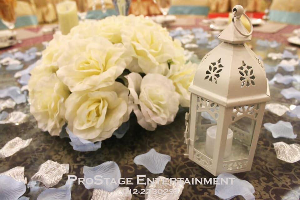 Bouquet, petal and mini candle lamp centerpiece