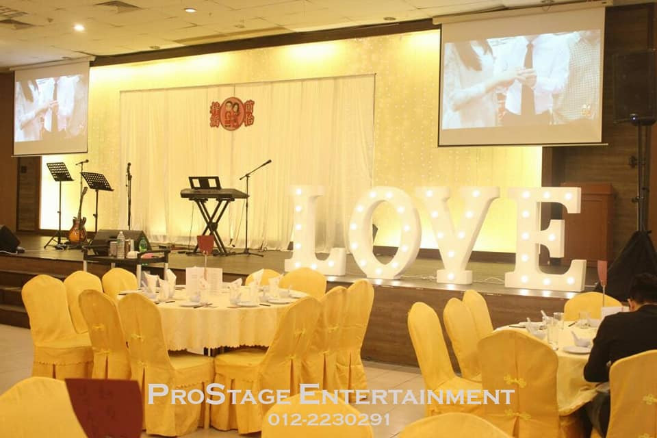 Stage white curtain backdrop with LOVE character sign