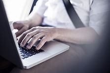 Man typing on keyboard linking reader to document for excel shortcut keys