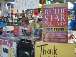 Teens promote the books at Faire