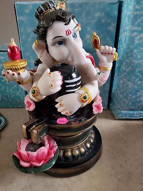 Ganesh holding Lingam
