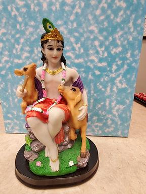 Krishna with 2 deers