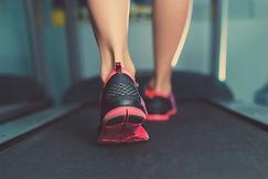 Female muscular feet in sneakers running