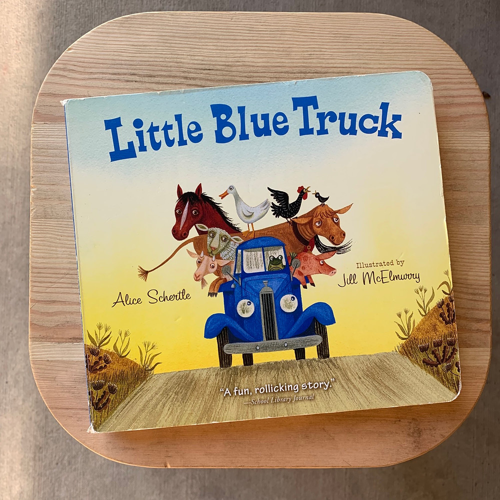 little blue truck, board, book