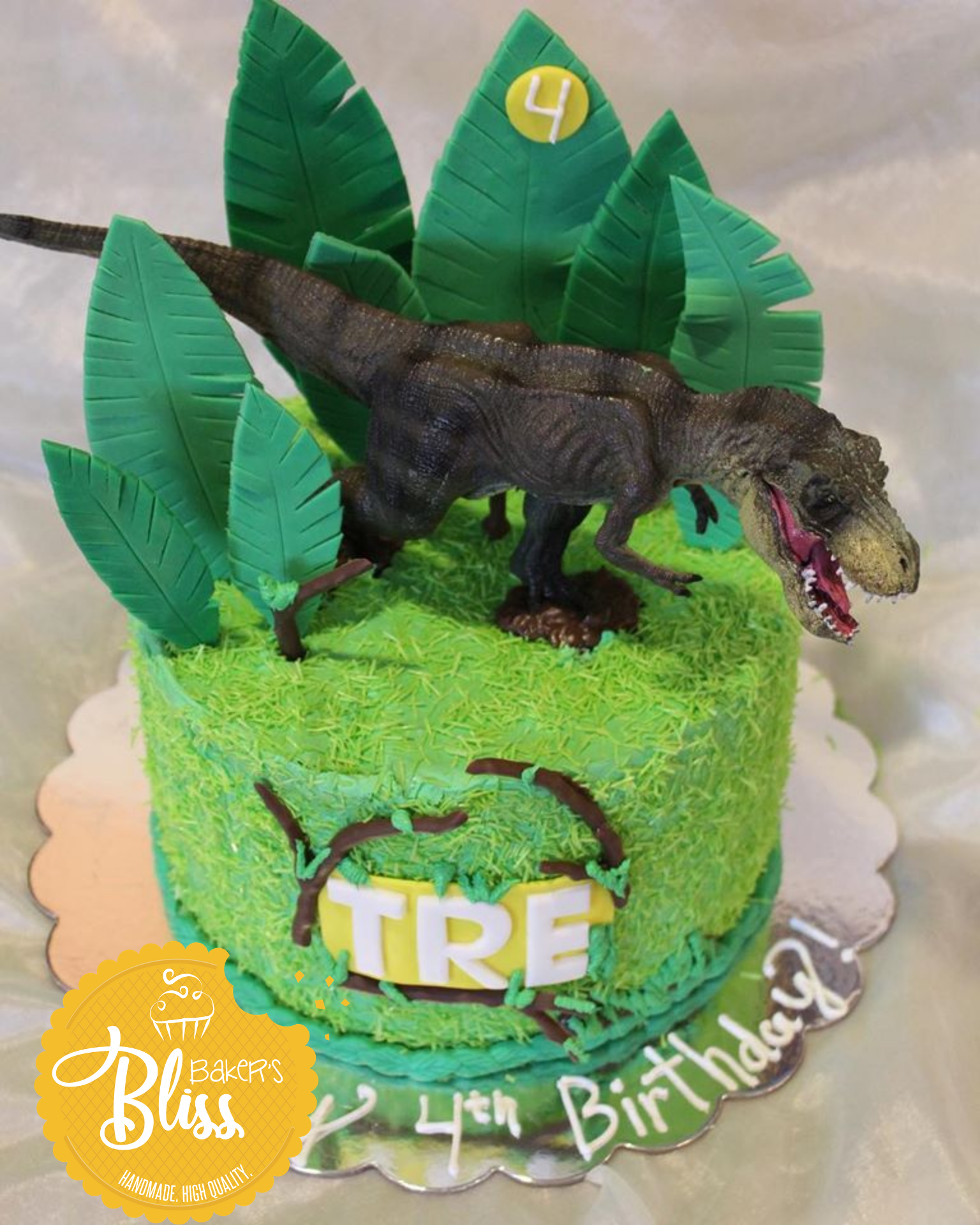 Green dinosaur theme birthday cake