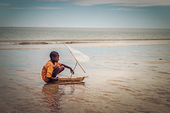 Malagasy Boy Playing on the Beach