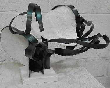 Sculpture métal et mortier.