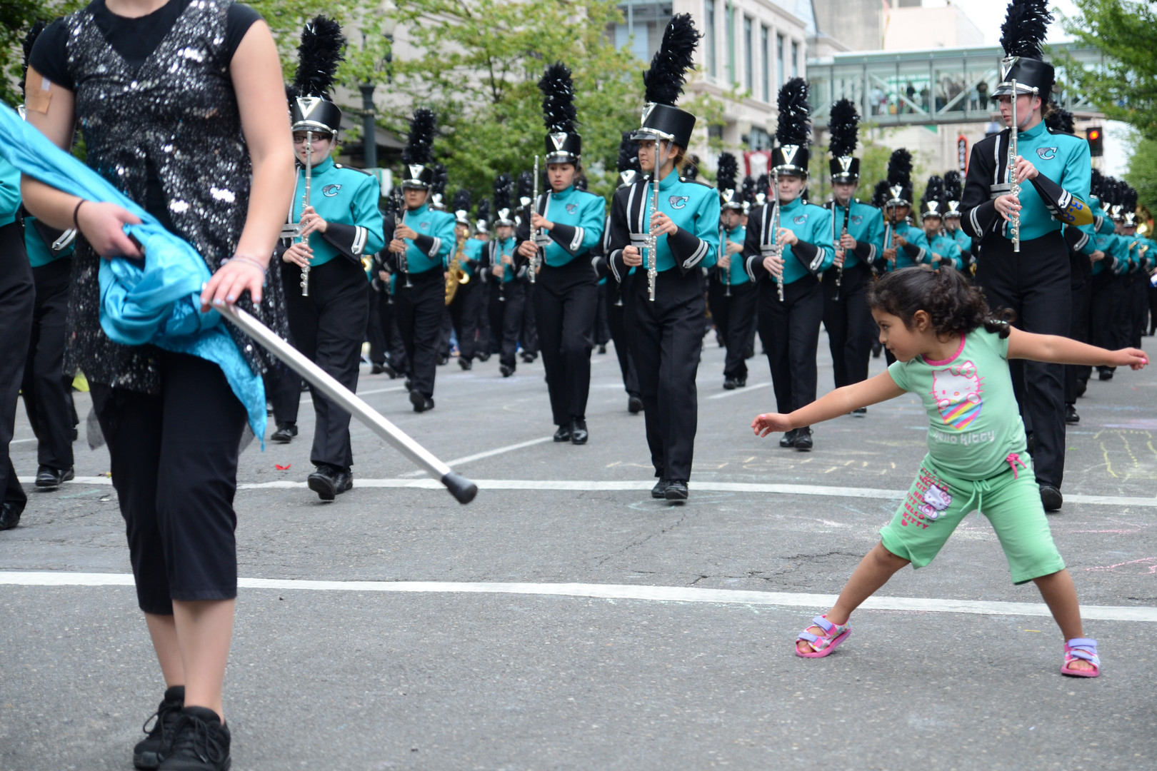 Rehanna Madrigal, 4, dances to the music from the Century High School marching band during the Portland Rose Festival Grand Floral Parade. (The Oregonian)