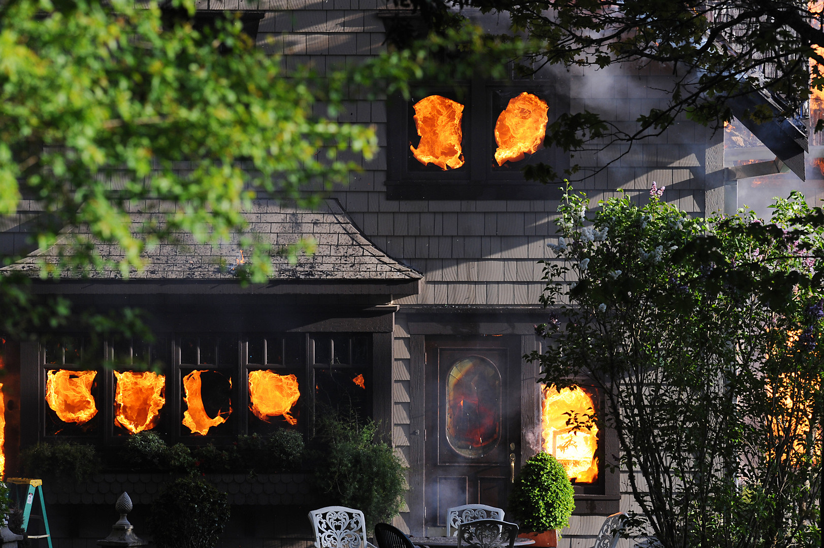 A fire broke out in a North Bend home on East Bay Drive just before 6 p.m. on Tuesday. North Bay and North Bend firefighters were on scene extinguishing the flames that enveloped the home. (The World newspaper)
