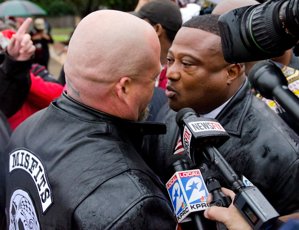 Robert Redmond, left, confronts Quanell X in the crowd of people protesting outside the Texas City Police Department on Sunday after family and friends of Carlton Smith held a press conference. Smith was shot and killed by police outside H.T.'s Lounge on Friday. (The Houston Chronicle)