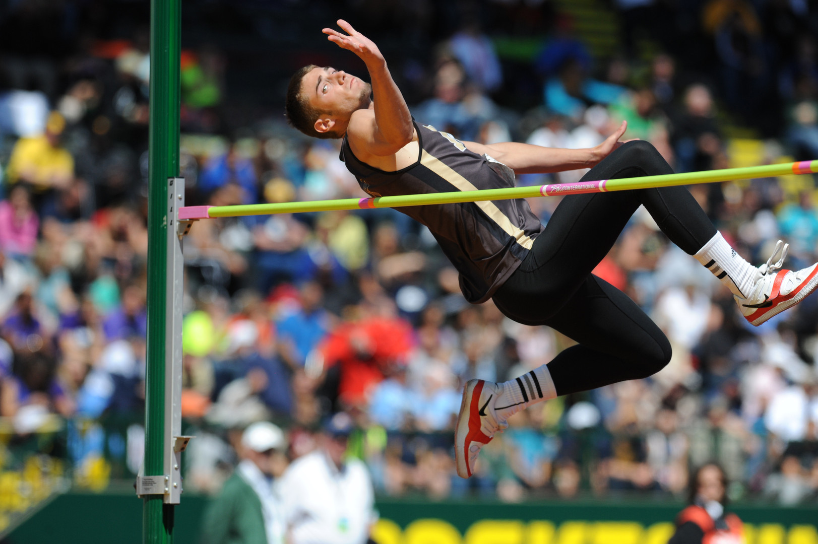 North Bend High School's Wyatt Cunningham attempts a height during the Class 4A state track meet Saturday. Cunningham won his second straight title in the event. (The World newspaper)