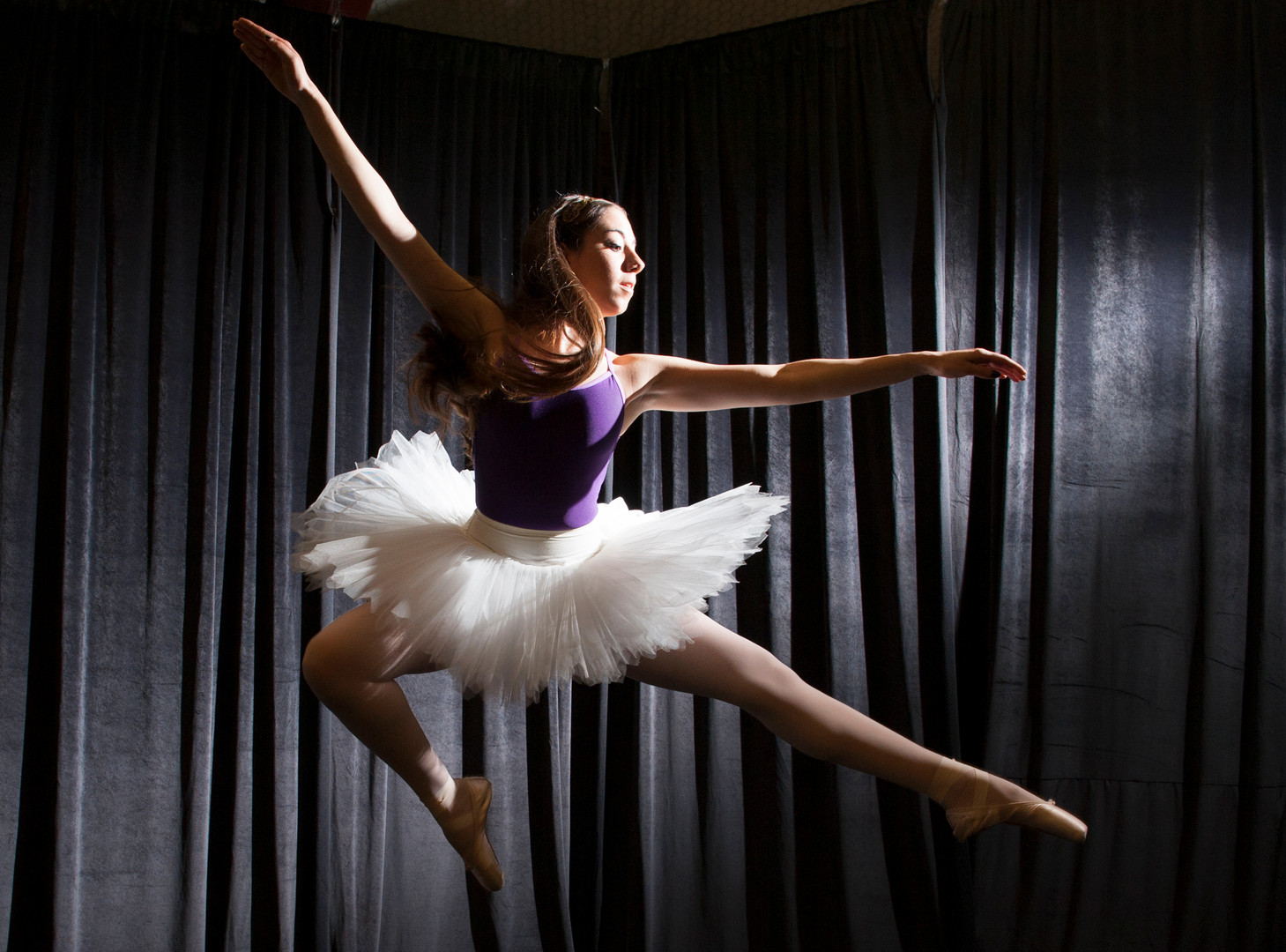 Mollie Becker, 16, demonstrates a Russian pas de chat ballet jump at the Royal Academy of Fine Arts in Webster, Texas. (Coast Monthly)