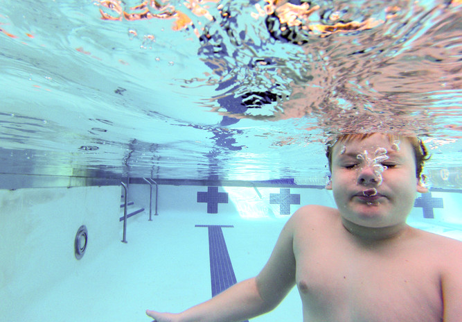 Bradley Claiborne, 12, swims at Mingus Park Pool in Coos Bay every Saturday morning. Bradley was diagnosed with autism at age 2 and loves being in the water. Helen Dietz, swim instructor at the pool, has worked with Bradley for about seven years and said the water helps dull his sensory issues. (The World newspaper)