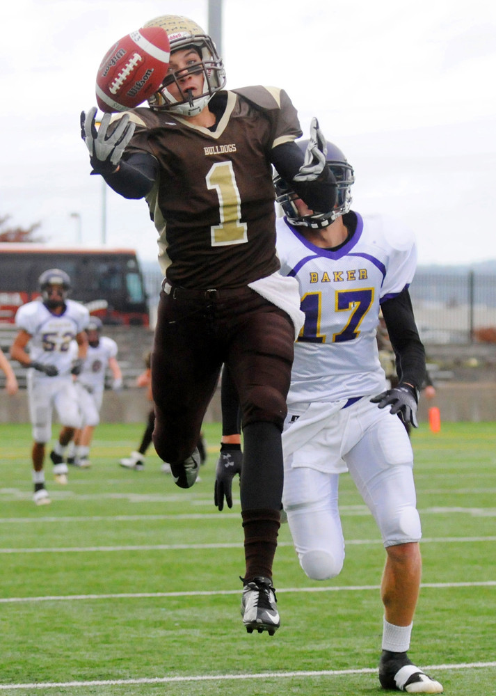 North Bend High School's Cameron Lucero barely misses a catch during the Class 4A championship game against Baker in Hillsboro, Oregon Saturday afternoon. (The World newspaper)