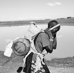 Maasai Woman Carrying Water 1