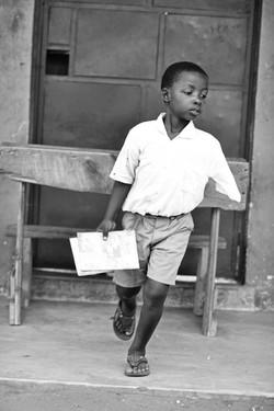 Maungu - boy with books