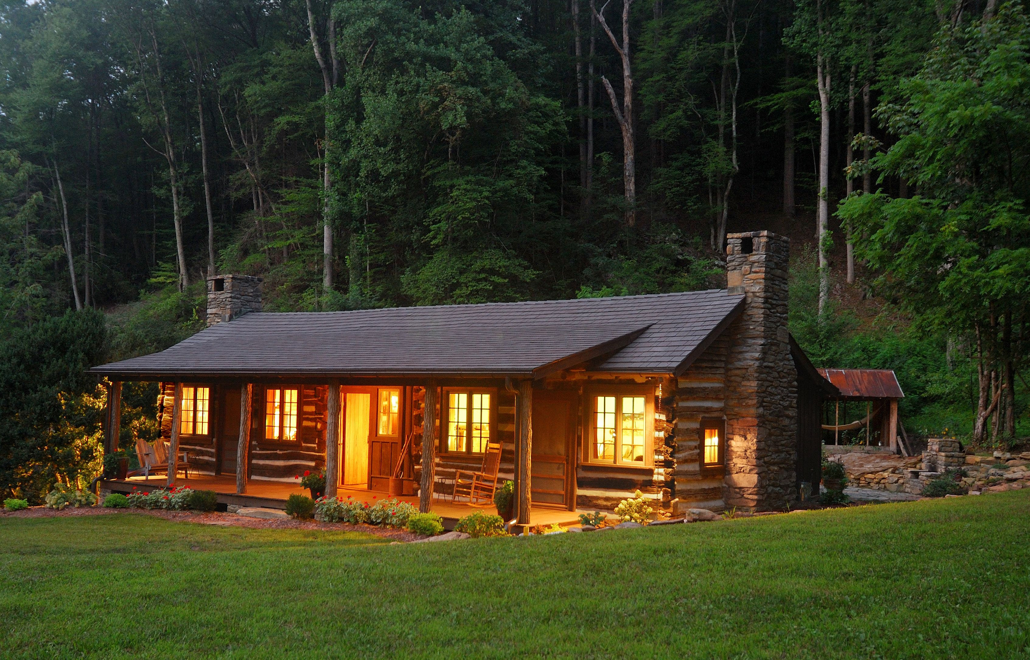 Log cabin in the woods by a lake - Rustic