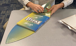 A yearbook cover turned into a surf-board