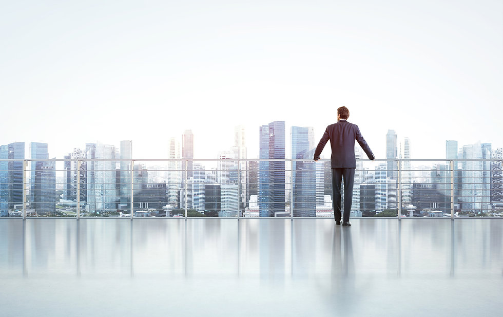 businessman-reflection-water-skyscraper-