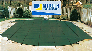 A safety cover by Merlin gives a sleek look to a closed pool