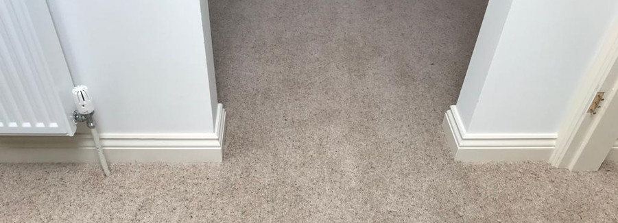 Carpet running through a doorway