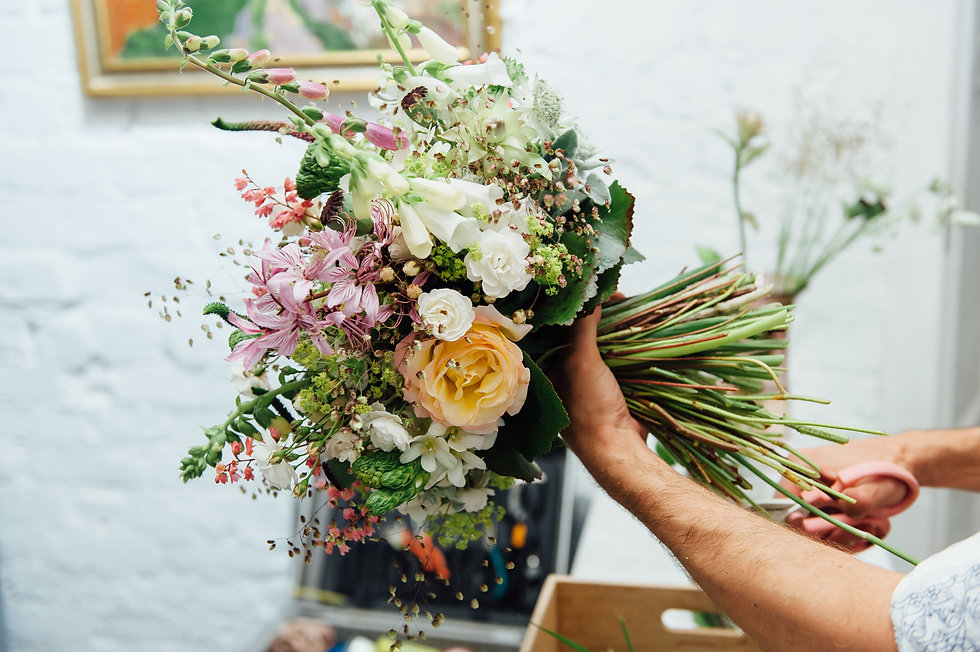 Florist finishing beautiful and rich spr