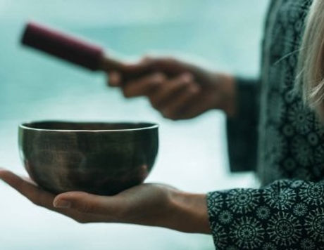 depositphotos_178559216-stock-photo-woman-holding-tibetan-singing-bowl_edited_edited.jpg