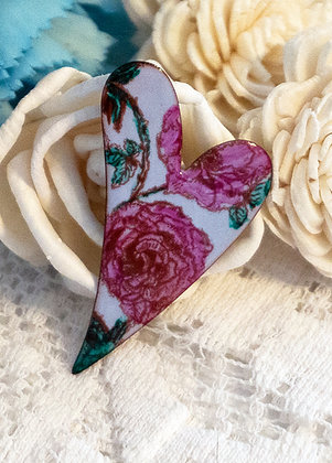 Hand-painted pink rose on blue heart