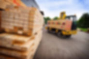 Image of lumber being loaded on delivery truck.