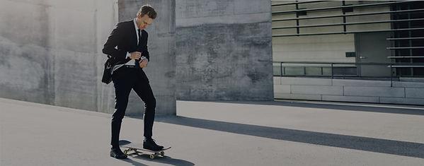 businessman-adjusting-his-necktie-standing-on-skat-52DLQN8.jpg
