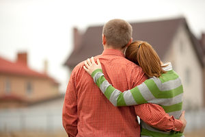couple looking on house .jpg
