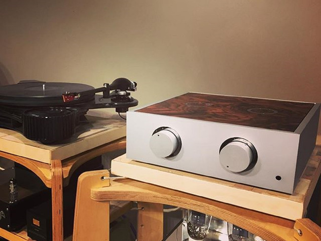 Natural pre-amplifier with chrome trim and a dark burr veneer lid