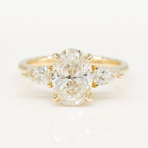 Oval with Pear Diamond Side Stones Engagement Ring