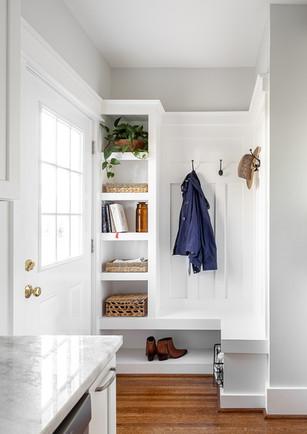 mudroom in kitchen. white built in nook