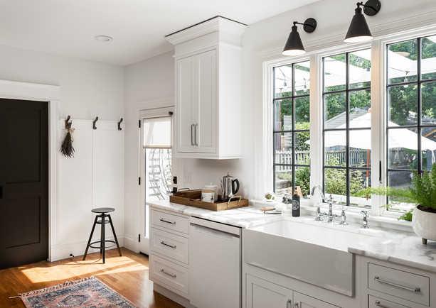 White shaker inset kitchen cabinet with marble counter tops. black frame window Louisville KY