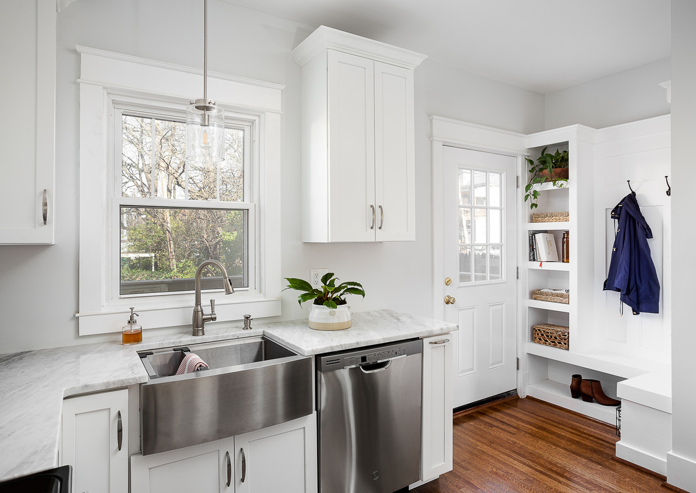 white shaker cabinets, hardwood floors in kitchen, stainless steel farm sink