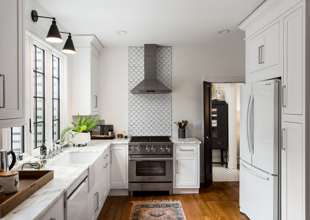 White kitchen, black framed window, marble counter tops