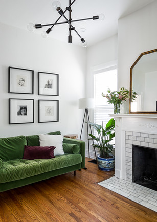 mid century inspired living room with green velvet sofa Louisville Ky