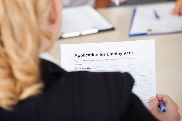 a human resources person looks at a job application