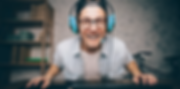 An IT support person smiles while wearing a headset
