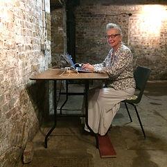 Yasmin Chopin writing in the crypt 2018