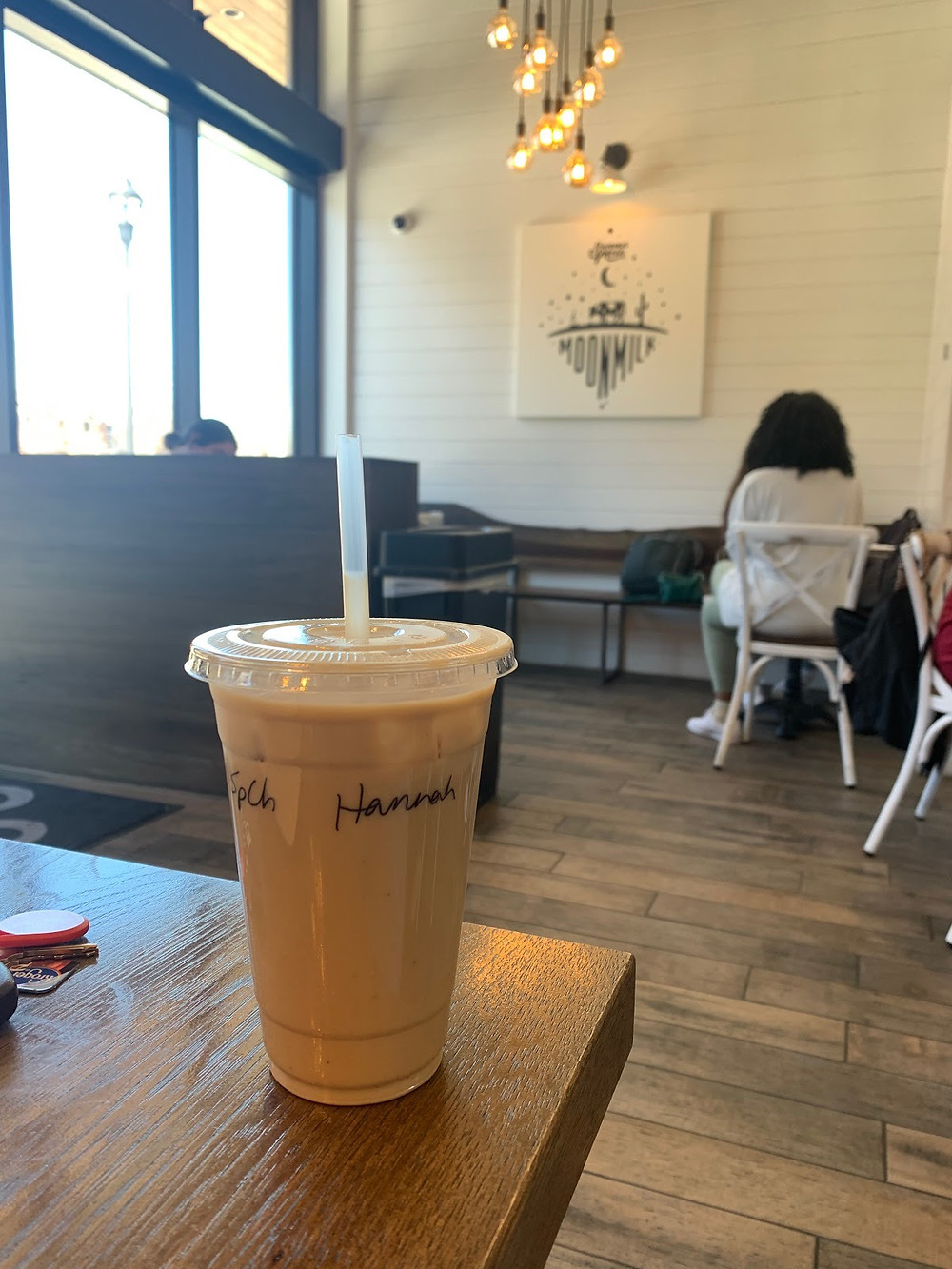 A picture of an iced coffee sitting on a table.