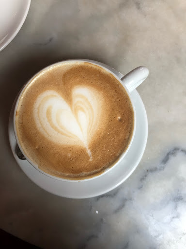 A picture of a cappuccino against a marble countertop.