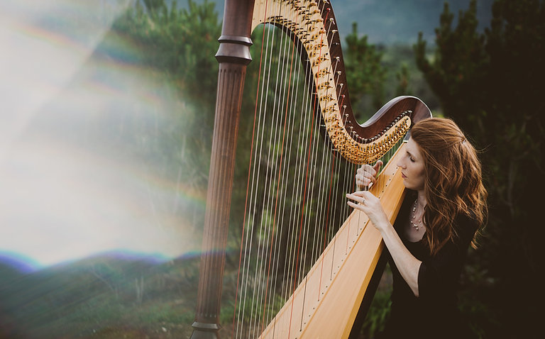 Harpist Mary Keener perform for a wedding at the Garden of the Gods Club in Colorado Springs