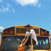 Prince Pronto with a basketball on top a School Bus