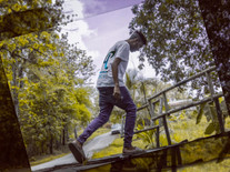 Prince Pronto walking over a bridge