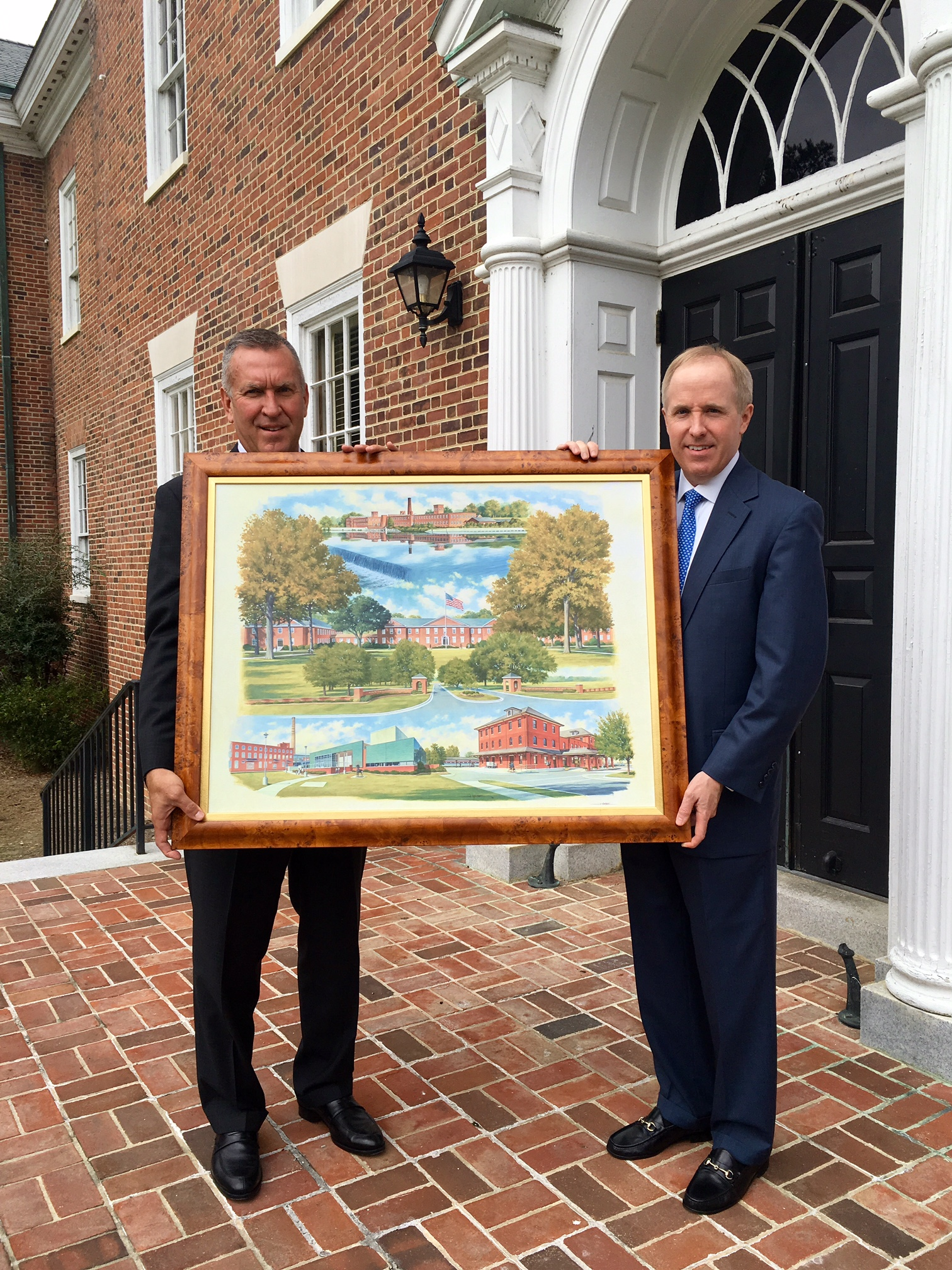 FCB presenting Wesleyan College with a print of the original as a thank you to their client
