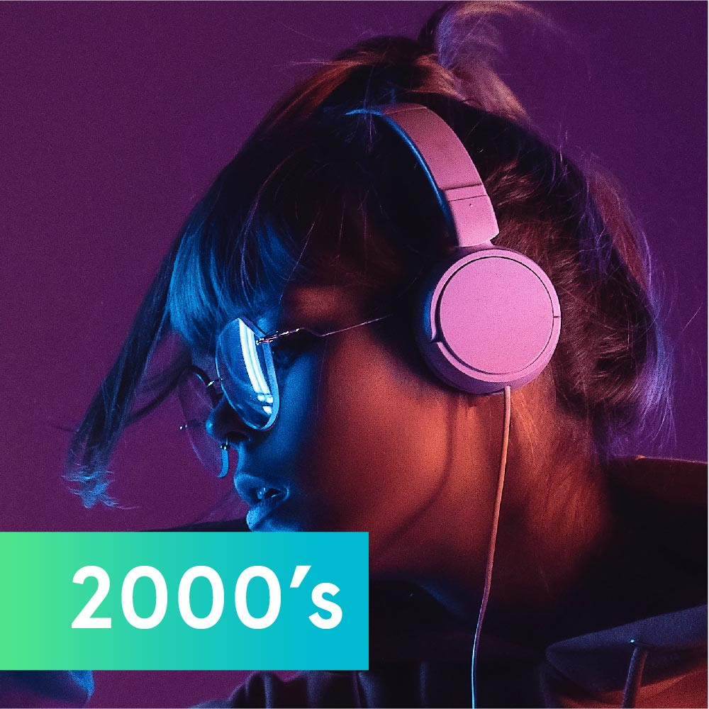 Girl listening to music with headphones to represent music in the 2000's