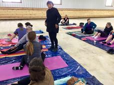Janice teaching a mat class